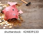 Broken Piggy Bank With Cash And ...