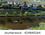 transportation in flooding.... | Shutterstock . vector #424840264