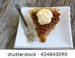 Slice Of Pecan Pie With Vanill...