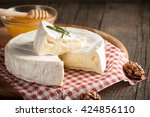 brie type of cheese. camembert... | Shutterstock . vector #424856110
