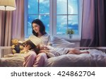 family reading bedtime. pretty... | Shutterstock . vector #424862704