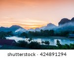 sunset at song river  vang... | Shutterstock . vector #424891294