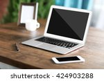 workplace with laptop  mobile...   Shutterstock . vector #424903288