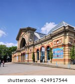 Small photo of LONDON - MAY 15, 2016. The Palm Court entrance to Alexandra Palace, a historic entertainment, exhibition and events venue dating from 1873, informally known as Ally Pally, located in north London, UK.