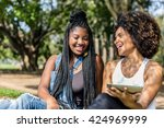afro friends using tablet in... | Shutterstock . vector #424969999