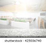 table top and blur interior of... | Shutterstock . vector #425036740