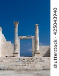 Small photo of View of historical ancient city of Laodicea in Denizli with high columns on bright blue sky background.