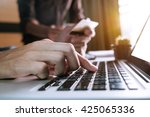 man hands using laptop and... | Shutterstock . vector #425065336