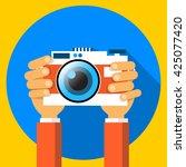 hands holding photo camera...   Shutterstock .eps vector #425077420