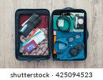 open traveler's bag with... | Shutterstock . vector #425094523