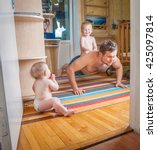 father and son are doing push... | Shutterstock . vector #425097814