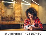 young woman at cafe drinking... | Shutterstock . vector #425107450
