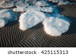 ice flakes on rippled sand | Shutterstock . vector #425115313