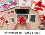 female customer receiving a... | Shutterstock . vector #425117284