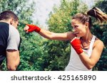 Woman Throwing A Punch To Man...