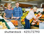 smiling customers choosing... | Shutterstock . vector #425172793
