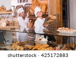 friendly smiling female bakers... | Shutterstock . vector #425172883