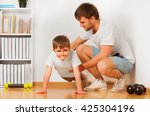 father teaching his kid son... | Shutterstock . vector #425304196