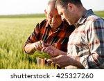 Two Farmers In A Field...