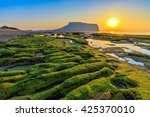 sunrise at jeju do seongsan... | Shutterstock . vector #425370010