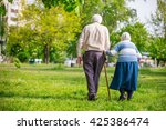 senior couple walking outdoors... | Shutterstock . vector #425386474