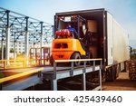 forklift is putting cargo from... | Shutterstock . vector #425439460
