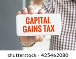 man hand showing capital gains... | Shutterstock . vector #425462080