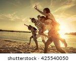 friends fun on the beach under... | Shutterstock . vector #425540050