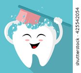 tooth with a toothbrush  smiling | Shutterstock .eps vector #425542054