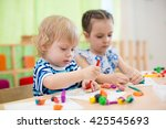 two kids doing arts and crafts... | Shutterstock . vector #425545693