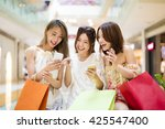 happy young woman  watching... | Shutterstock . vector #425547400