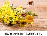 rape oil and flower on wooden... | Shutterstock . vector #425557546