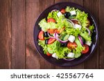 greek salad  lettuce  tomatoes  ...   Shutterstock . vector #425567764