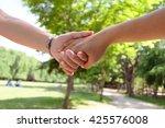 lovers couple holding hands | Shutterstock . vector #425576008