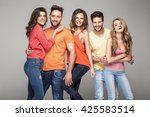 Group Of Smiling Friends Wear...
