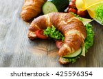 croissant sandwich with cheese... | Shutterstock . vector #425596354