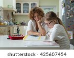 mother helping daughter with... | Shutterstock . vector #425607454