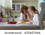 mother helping daughter with... | Shutterstock . vector #425607466