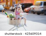little girl shopping with cart... | Shutterstock . vector #425609314