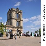 Small photo of LONDON - MAY 15, 2016. A corner tower and outdoor cafe at Alexandra Palace, a historic entertainment, exhibition and events venue dating from 1873, informally known as Ally Pally, in north London, UK.