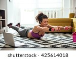 young woman exercising at home... | Shutterstock . vector #425614018