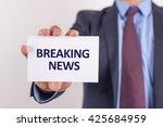 man showing paper with breaking ... | Shutterstock . vector #425684959
