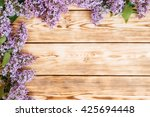 bunch of lilac flowers on brown ... | Shutterstock . vector #425694448