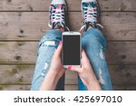 young woman using smart phone | Shutterstock . vector #425697010