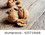 walnut kernels and whole... | Shutterstock . vector #425714668