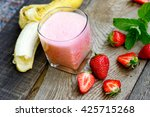 banana   strawberry smoothie in ... | Shutterstock . vector #425715268