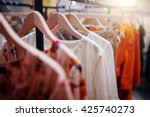 Stock photo clothing on hanger at the modern shop boutique 425740273