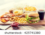 fast food and unhealthy eating... | Shutterstock . vector #425741380