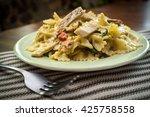 chicken farfalle alfredo with... | Shutterstock . vector #425758558