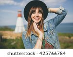 young woman sitting in field ... | Shutterstock . vector #425766784